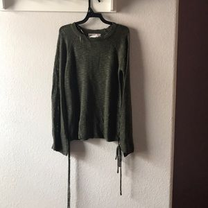 Green sweater with side ties